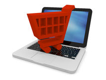 Red shopping trolley on laptop Royalty Free Stock Image