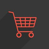 Red shopping trolley with long shadow Stock Photography