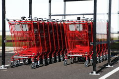 Red Shopping Trolleys Outdoors Royalty Free Stock Image