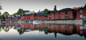 Red shore houses on the riverbank of Porvoo river. Porvoo, Finland royalty free stock photos