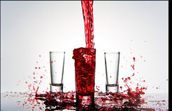 Red Shot Glass Pour Stock Photo