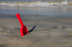 Red shovel at the beach Stock Images