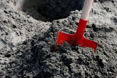 Red Shovel-Digging Out of Debt Royalty Free Stock Images