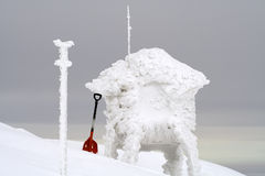 Red shovel in the snow Royalty Free Stock Image
