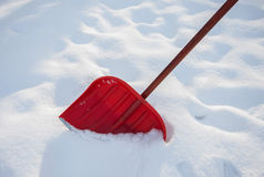 Red shovel for snow Stock Photos