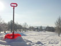 Forgotten toy shovel in the snow Stock Images
