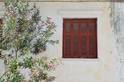 Red shutter. Building with red shutter,Argostoli,Lassi Greece Stock Photo
