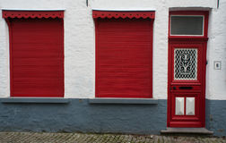 Red shutters and entrance Stock Photos