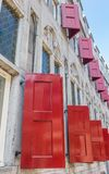 Red shutters of the historic Zoudenbalch building in Utrecht. Holland Stock Image