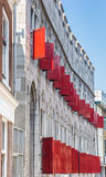 Red shutters of the historic Zoudenbalch building in Utrecht. Holland Royalty Free Stock Image