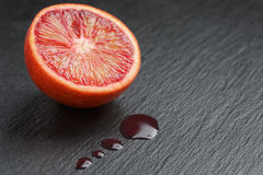 Red sicilian orange sliced on slate board with Royalty Free Stock Photos