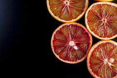Red sicilian oranges sliced. Black space for text royalty free stock image