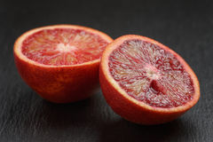 Red sicilian oranges sliced on slate board Stock Images