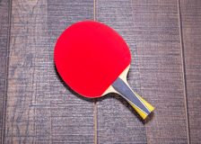 Red side of table tennis bat on wood Royalty Free Stock Image