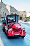 Red sightseeinn car in Rhodes Greece Royalty Free Stock Photography