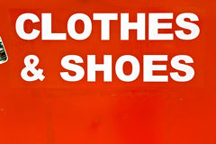 Red Sign. Sign CLOTHES & SHOES on the red grunge background royalty free stock photo