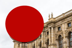 Red sign with copy space and museum building, statues at background Stock Photos