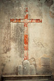 The red sign of the cross on the wall. Stock Photo