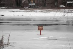 Red sign dangerously thin ice without inscription Snowtime danger red stock photography