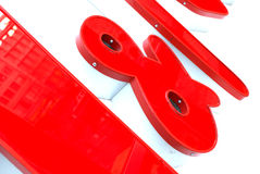 Red & sign detail. An element of a store sign with silver screws Royalty Free Stock Images