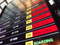 Red sign final call flights on the departure table of an airport. Many red sign final call flights on the departure table of an airport Stock Photos