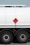 Red sign on fuel tanker truck. Tanker truck with flammable warning sign stock image