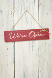 Red Sign In Front Of A Wooden Wall - We Are Open Royalty Free Stock Photos