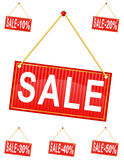 Red sign label with the inscription sale hanging on a rope vecto Stock Photo