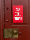 Red sign for no cell phone usage Royalty Free Stock Image