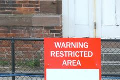 Warning Restricted Area. A red sign that reads Warning Restricted Area Stock Image