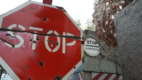 Red sign stop control on a military post. stock footage