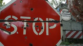 Red sign stop control on a military post. stock video footage