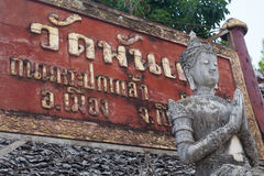 Red Sign Thailand Text with stone and marble gray statue pray cl Stock Photo