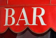 Red sign with white lettering on an elegant Italian bar Stock Image