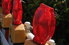 Red signal lamps at temporary fencing at a construction site stock photo