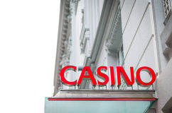 Red signboard of casino on old white building. Royalty Free Stock Photography