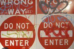 Red signs reading �Wrong Way, Do Not Enter� covered with graffiti Los Angeles stock images