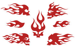 Red silhouettes of flaming skulls. Emblem set, old school fire logos, isolated  illustration Royalty Free Stock Image
