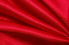Red silk. Silk background, material pattern , close up royalty free stock photography