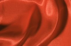 Red silk. Background made of a piece of red silk Stock Photography
