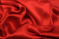 Red silk. Textile abstract background Stock Images