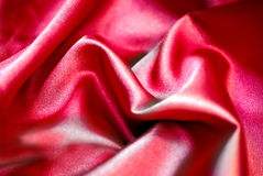 Red silk. Shiny red silk as background royalty free stock photo