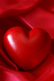 Red silk background with heart Royalty Free Stock Photo
