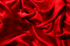Red silk background. A lot of folds Royalty Free Stock Image
