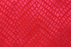 Red silk background with a pattern Royalty Free Stock Photography