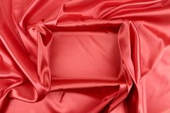 Red silk. Background with some soft folds and highlights stock image
