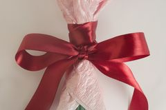 Red silk bow on bouquet of flowers, tender toning, festive bouquet. royalty free stock image