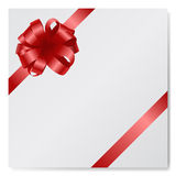 Red silk bow on empty paper card isolated at white Stock Photo