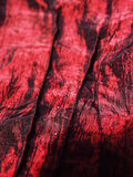 RED SILK. CHANGING WITH SEAMS Stock Photography