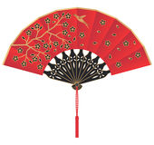 Red Silk Chinese Fan with Flowers and Bird. A red silk Chinese fan decorated with golden flowers and a bird. At the bottom is a cord with a tassel Royalty Free Stock Images